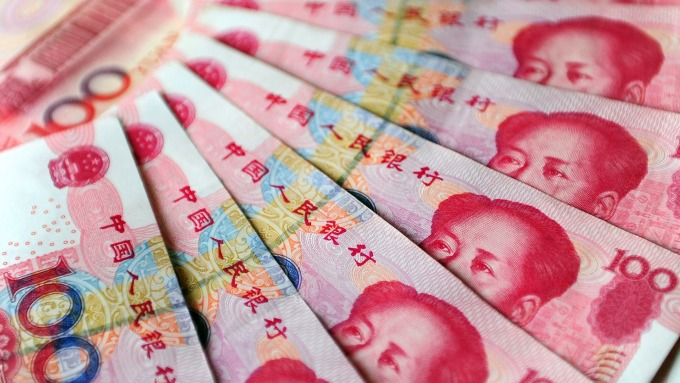 人民幣中間價報6.9154下調34點(圖:AFP)