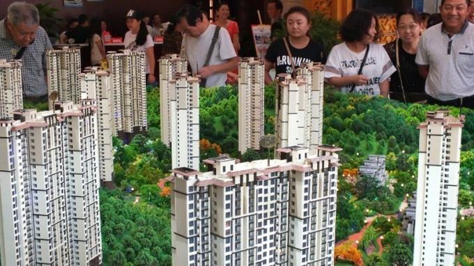 中國房地產企業未來3年償債壓力逐年提高。(圖:afp)