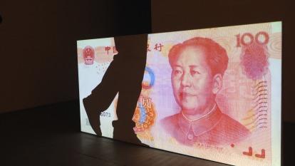 ING預估,人民幣兌美元,將於明年底貶至7.3。(圖:AFP)