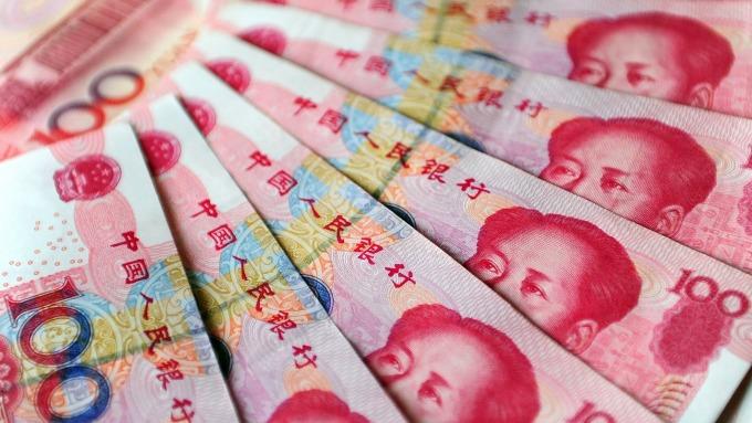 人民幣中間價報6.9163下調98點(圖:AFP)