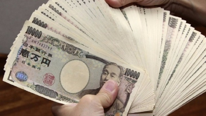 摩根大通:明年日圓意外走軟的風險不容忽視。(圖:AFP)