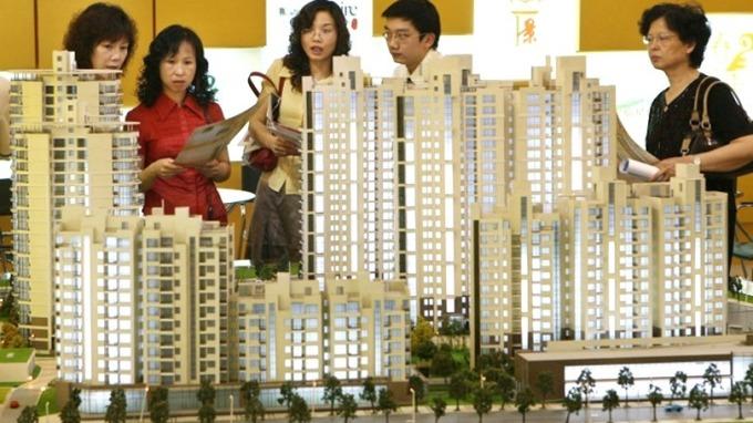 明年中國房地產商債務高達人民幣3850億元。