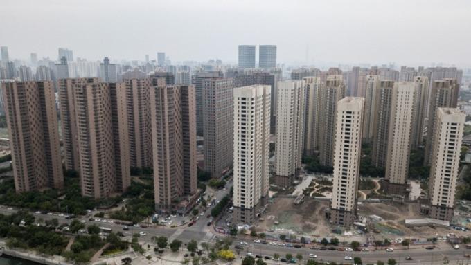 中國房地產開發商急於發行短債以償舊債。(圖:AFP)