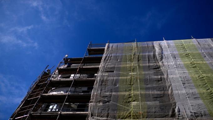 區塊鏈技術能降低建築業的貪污問題。(圖:AFP)