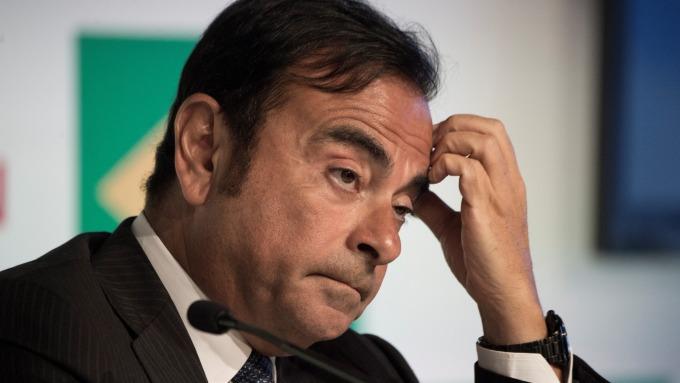 戈恩被捕前曾想合併雷諾和日產。(圖:AFP)