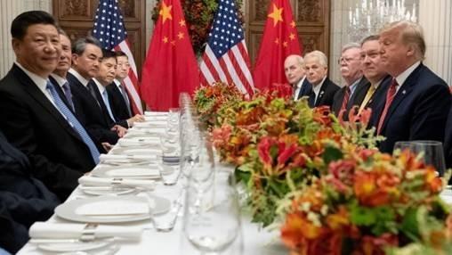 (圖一:別怒目相視、請稍息!2018年12月2日G20會議,AFP)