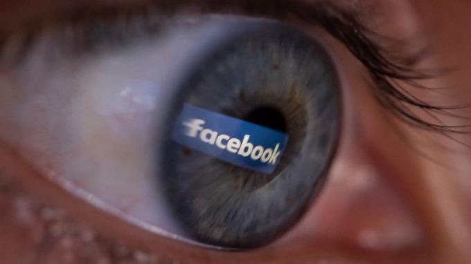 谷歌、臉書面臨監管打擊(圖:AFP)