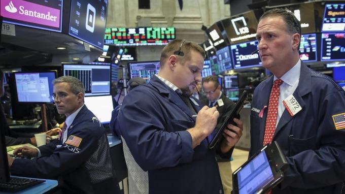 圖:AFP  美國股市明年風險依舊