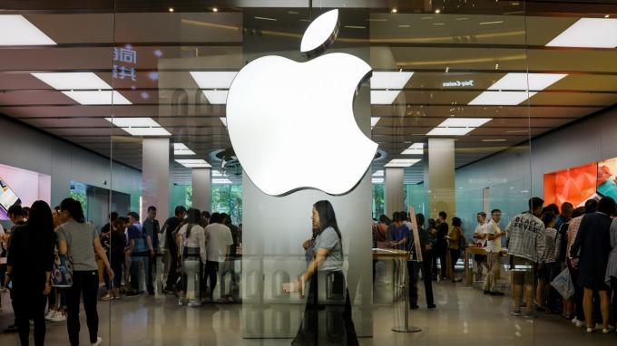 蘋果盤前股價走跌。(圖:AFP)