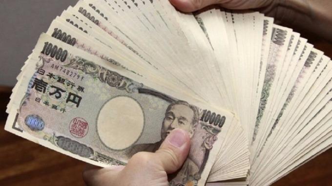 日圓來到100大關,幾乎已成分析師們的共識。(圖:AFP)