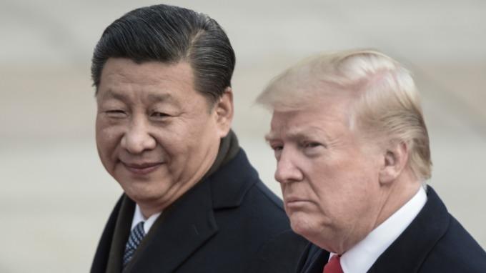 習近平(左)與川普(圖:AFP)