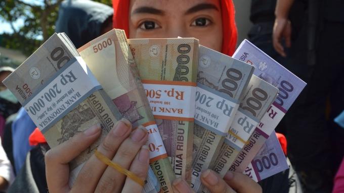 策略師:Fed開始保持耐心 新興市場貨幣終於出頭天。(圖:AFP)
