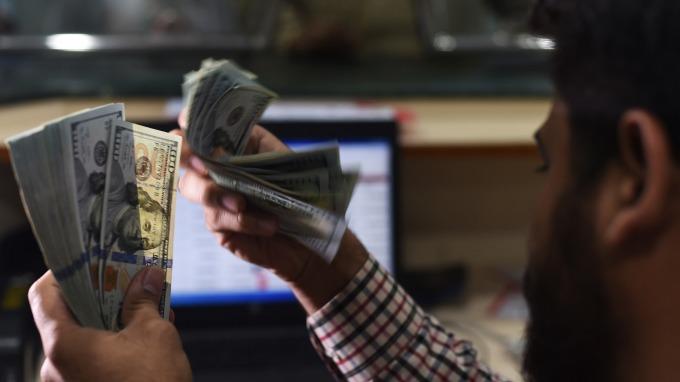 截至2月11日,美元已連續8個交易日走揚。(圖:AFP)