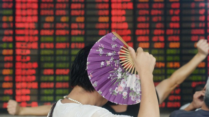 摩根大通看好資金回歸中國股市。(圖:AFP)