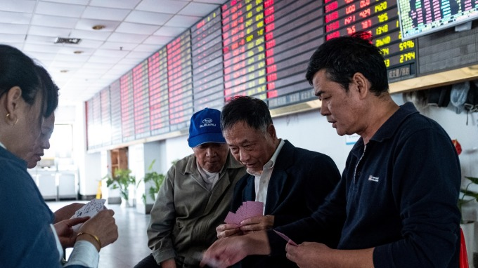 中國證監會官網於上週公告,已核准國際貨幣基金組織 (IMF) 人民幣合格境外機構投資者(RQFII)資格。(圖:AFP)