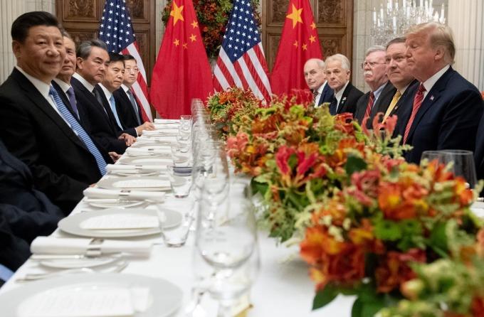 去年 12 月川習會後,美中宣布關稅休戰。(圖:AFP)