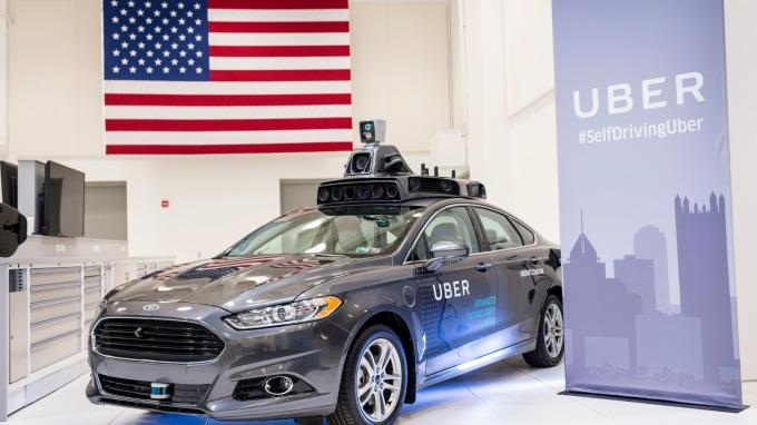 根據華爾街日報的報導,軟銀等其他企業將投資Uber自駕車部門10億美元 (圖:AFP)