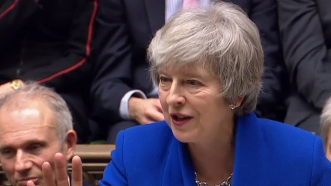 圖:AFP  英國首相梅伊