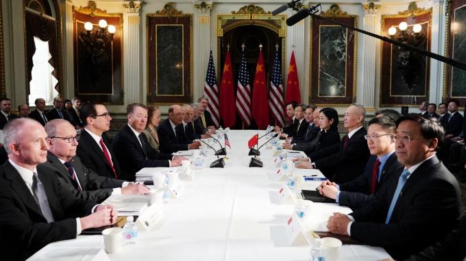 美中貿易代表 2 月底於華府進行談判。(圖:AFP)