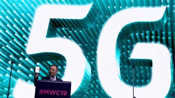 韓國電信執行長在MWC大會。(圖:AFP)