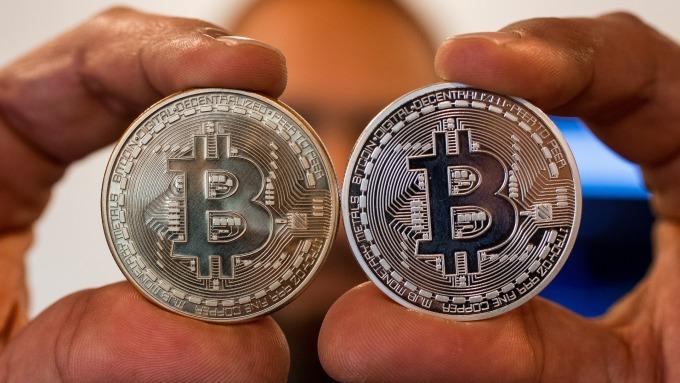 比特幣出現「莫名漲勢」。(圖:AFP)
