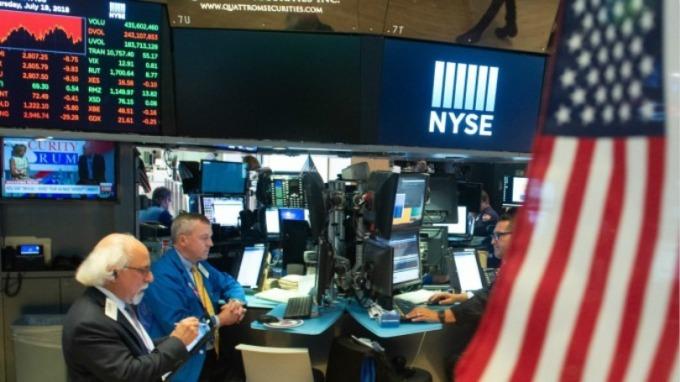 週五美股四大指數同步上揚。(圖:AFP)