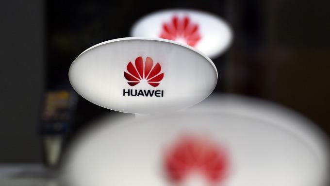 外媒報導,華為願意破例賣 5G 晶片給蘋果。(圖:AFP)