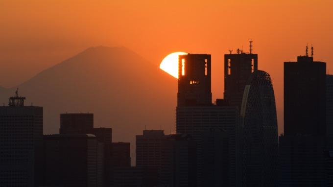 日本上年度核心CPI 上揚0.8%,未達日本央行2%通膨目標的一半水準 (圖:AFP)