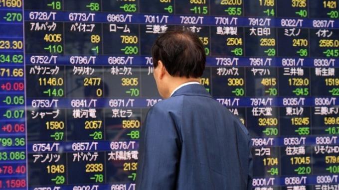 日本央行持有的ETF部位龐大。(圖:AFP)