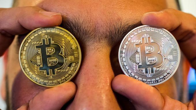 加密貨幣交易所幣安遭駭客攻擊,共計7000枚比特幣遭竊。(圖:AFP)