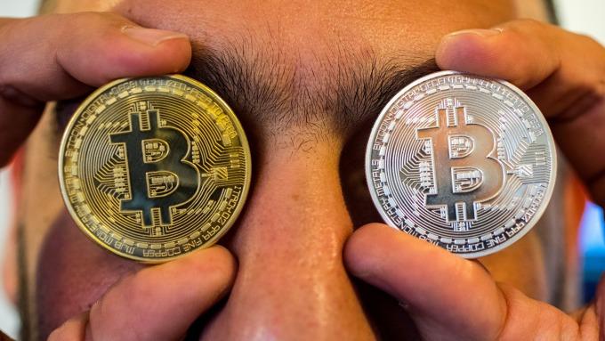 比特幣價格漲破6000美元。(圖片:AFP)