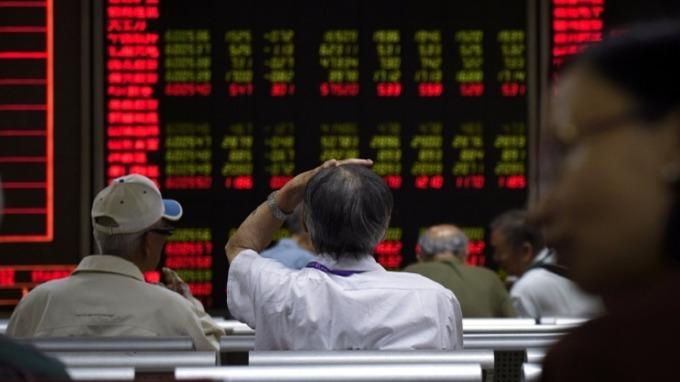 外資加速自陸股撤出。(圖片:AFP)