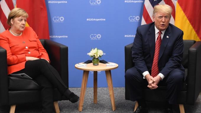 川普和德國總理梅克爾。(圖片:AFP)