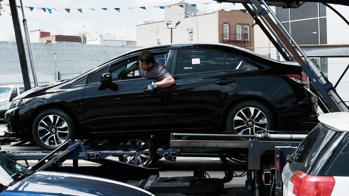 (圖片:AFP) 美國有意限制歐盟與日本汽車進口