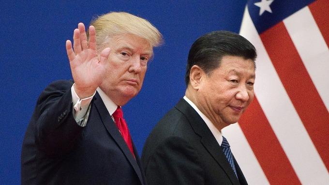 美中貿易戰延燒,拖累全球經濟成長。(圖片:AFP)