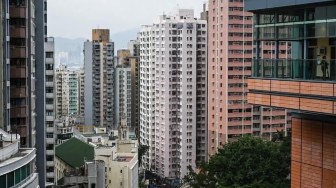 建商戒急用忍,房市吹起減量經營風。(圖:AFP)