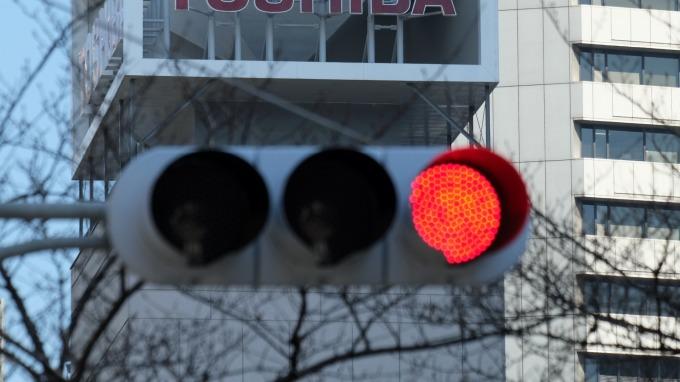 日本擬開放交通號誌系統架設5G基地台(圖片:AFP)