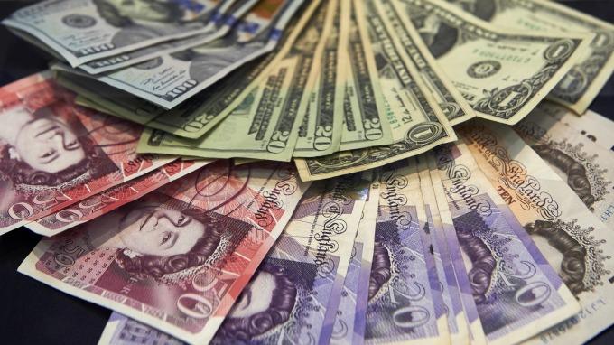 紐約匯市–美經濟優於預期 美元站回97整數關卡 (圖片:AFP)