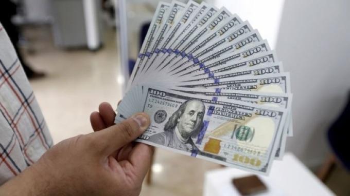 貿易戰已爆發、貨幣戰還遠嗎?Fed的美元指標透露玄機 (圖片來源:AFP)