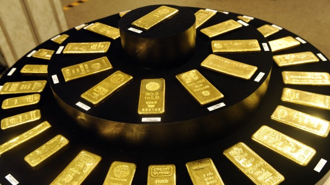 國際情勢不穩 投機者大增黃金多單(圖片:AFP)