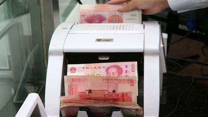 中國央行仍力守人民幣 分析師:至少維持到G20峰會(圖片:AFP)