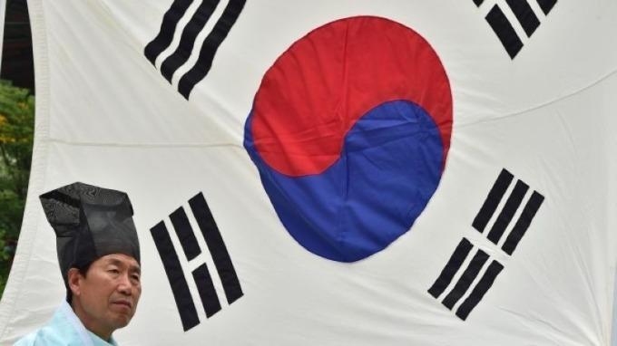 南韓央行正發出信號 未來可能降息? (圖片:AFP)
