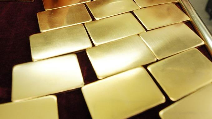 貴金屬盤後─各地政局擔憂 支撑黃金收高5.60美元 連二天上漲 (圖片:AFP)