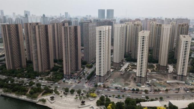 打房奏效,澆熄中國房市火苗(圖片:AFP)