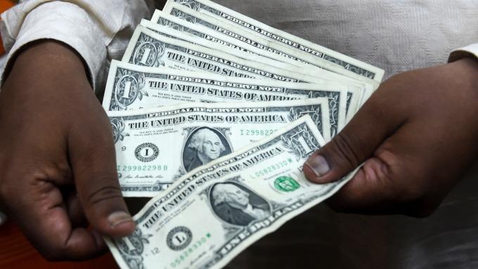 中日減持美債 但誰卻在大買美債? (圖片: AFP)