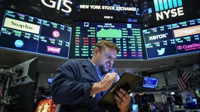 Fed會議周 如何與市場波動對作 獲利入袋?(圖:AFP)