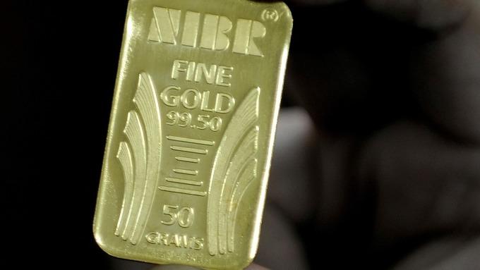貴金屬盤後─黃金收低 Fed暗示立場改變後 反彈上揚 (圖片:AFP)