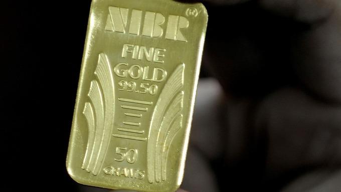 貴金屬盤後─降息展望及美伊緊張 黃金收高18.1美元 創近六年高點 (圖片:AFP)