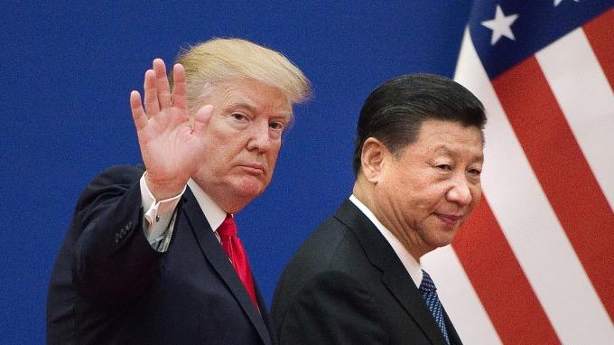 美中貿易戰延燒,但台灣、南韓產業,有機會漁翁得利。(圖片:AFP)