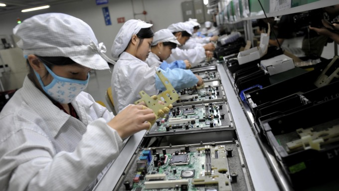 工業電腦龍頭研華、鴻海旗下的樺漢及工業富聯(FII)積極拓展平台服務,擺脫純硬體製造。(示意圖:AFP)